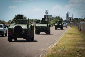 Texas National Guard vehicles depart to the Texas-Mexico border in 2014.