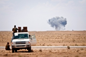 Syrian Democratic Forces watch as a coalition airstrike hits ISIS target near the Iraq-Syria border, May 13, 2018.