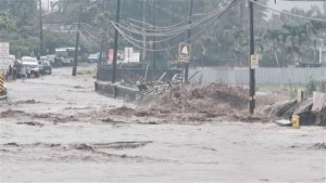 Floodwaters stream down a street in Hauula, Hawaii, on March 9, 2021.Adam Palmer via Reuters.
