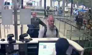 This image from security camera video shows Michael Taylor, center, and George-Antoine Zayek at passport control at Istanbul airport in Turkey.