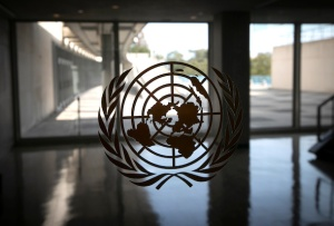 The United Nations logo is seen on a window in an empty hallway at United Nations headquarters during the 75th annual U.N. General Assembly high-level debate. REUTERS pic