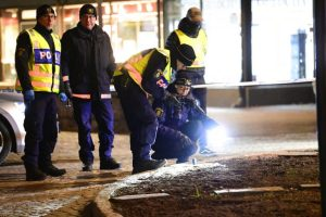 Police are seen in the area after several people were attacked in Vetlanda, Sweden, Wednesday, March 3, 2021.