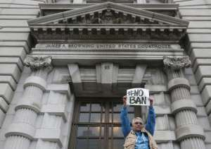 Karen Shore holds up a sign outside the U.S. 9th Circuit Court of Appeals. (Jeff Chiu/Associated Press)