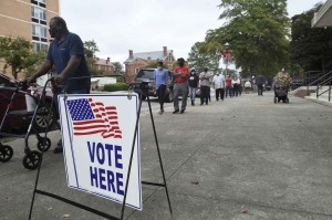 Voters wait in line to cast their ballot during early voting at the Bell Auditorium in Augusta, Ga.