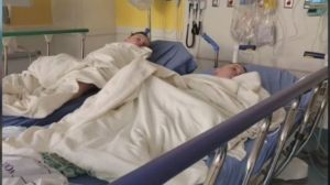 Hillarie Galazka's twins are seen here holding hands in the hospital after she gave her life to save theirs.