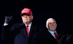 President Donald Trump arrives with Vice President Mike Pence for a Make America Great Again rally at Cherry Capital Airport in Traverse City, Michigan on Nov. 2, 2020.