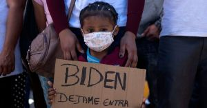 Dareli Matamoros, a girl from Honduras, holds a sign asking President Joe Biden to let her in during a migrant demonstration demanding clearer United States migration policies,