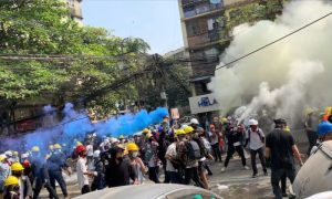 Protesters set off smoke grenades to block the view from snipers in Sanchaung, Yangon, Burma,