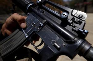 An AR-15 bears a marking showing it was made in Hartford, Conn. (Gary Coronado/Los Angeles Times/TNS)