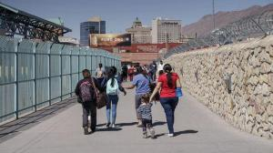 "Migrants who had been in Mexico under the Migrant Protection Protocols, or the ""Remain in Mexico"" program, enter the United States at the Paso del Norte Bridge in El Paso, Texas, on March 10, 2021."