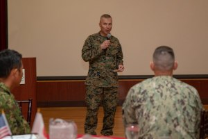 Marine Corps Col. Christopher J. Bronzi, center, commanding officer of 15th Marine Expeditionary Unit, gives his remarks during the closing ceremony for Exercise Iron Fist 2020.