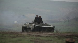 Service members of the Ukrainian armed forces drive an armored vehicle during training at a firing range in the Donetsk region, Ukraine, on April 20, 2021.