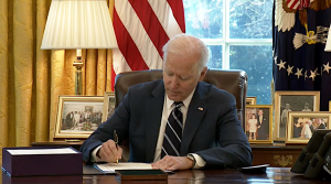 President Joe Biden signs the American Rescue Plan package of legislation March 11, 2021, at in the Oval Office at the White House.  Facebook / The White House