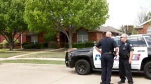 Police stand at the scene on Pine Bluff, Monday, April 5, 2021, in Allen, Texas,