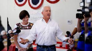 California Republican gubernatorial candidate John Cox speaks during campaign stop as Rep. Mimi Walters, R-Calif., looks on in Irvine, Calif.