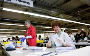 Election workers with vote-by-mail ballots for the Washington presidential primary, Renton, Wash., March 10, 2020. ( Jason Redmond/Getty)