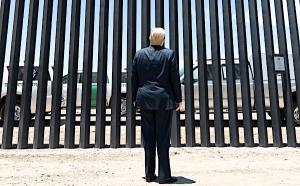 President Donald J. Trump stands before a plaque Tuesday, June 23, 2020, commemorating the 200th mile of new border wall along the U.S.-Mexico border near Yuma, Arizona.