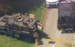 Deputies shot in Watauga County SWAT teams and other law enforcement officers stage outside a home in Boone after two deputies were shot Wednesday morning.