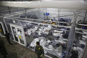 FILE - In this March 30, 2021 file photo, minors lie inside a pod at the Donna Department of Homeland Security holding facility,