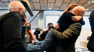 REUTERS Activists hugged in court after the judge delivered the verdict.