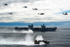 US Navy and Marine Corps aircraft over HMS Queen Elizabeth and a US Navy landing craft, air cushion during a photo exercise, May 17, 2021