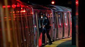 A Metopolitan Transportation Authority Police(MTA) officer looks for passengers at,