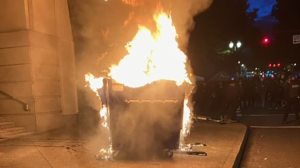Marchers in Portland on Tuesday lit a dumpster on fire. (Portland police)