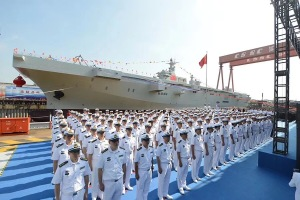 China's People's Liberation Army Navy (PLAN) sailors stand before the first Type 075 class of amphibious assault ship, Sept. 25, 2019.
