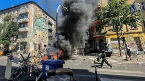 REUTERS Protesters set a barricade alight outside 94 Rigaer Straße