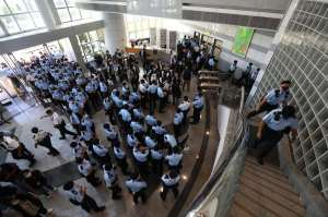Dozens of Hong Kong police enter Apple Daily's headquarters in Tseung Kwan O on June 17, 2021.