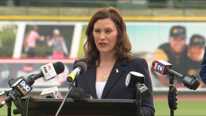 Gov. Gretchen Whitmer announces May 20, 2021, she will lift many COVID-19 restrictions on June 1.   Screenshot of WoodTV livestream