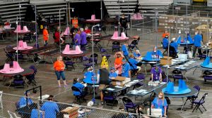 Contractors working for Florida-based company, Cyber Ninjas, which was hired by the Arizona Senate, audit ballots at Veterans Memorial Coliseum in Phoenix, Ariz.,
