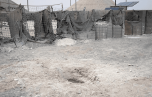 Impact crater at Al Asad Air Base, Iraq, following a rocket attack on March 3, 2021.