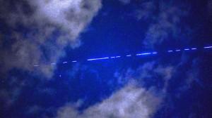 A satellite streaking through orbit.