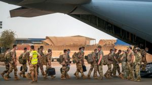 French Barkhane force soldiers who wrapped up a four-month tour of duty in the Sahel board a US Air Force C130 transport plane, leave their base in Gao, Mali Wednesday June 9, 2021.