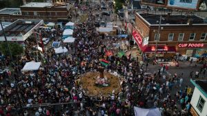 In a photo taken with a drone, people gather at George Floyd Square on the one-year anniversary of Floyd's death, Tuesday, May 25,