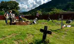 Members of the International Committee of the Red Cross (ICRC) work in the recovery of mortal remains of people killed by armed groups during the country's armed conflict, in a cemetery in the Catatumbo jungle, in Colombia.