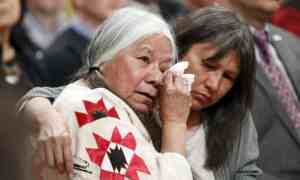 Residential School survivor Lorna Standingready, left, is comforted during the Truth and Reconciliation Commission of Canada closing ceremony in Ottawa .Blair Gable/Reuters
