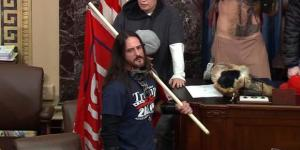 In this image from US Capitol Police video, Paul Allard Hodgkins, 38, of Tampa, Fla., front, stands in the well on the floor of the US Senate on January 6, 2021, at the Capitol in Washington.