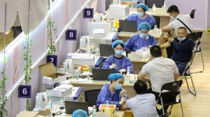 People receiving the China National Biotec Group (CNBG) COVID-19 coronavirus vaccine in Nantong, in China's eastern Jiangsu province, on July 5, 2021. (STR/AFP via Getty Images)