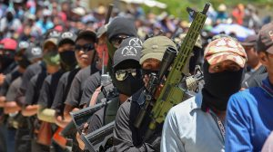 """Vigilantes of """"El Machete"""" as they call themselves, an armed group made up mostly of indigenous people to defend themselves against drug cartels, are seen during an assembly with indigenous communities,"""