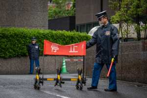 Security guards stand at an entrance to the Tokyo District Court. (Yuichi Yamazaki/Getty Images/TNS)
