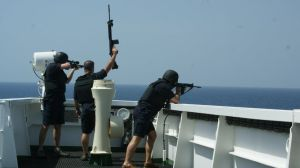 """These British maritime security guards are """"showing weapons"""" to ward off pirates from the bridge of a merchant tanker."""