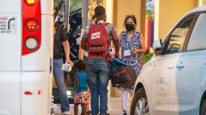 Volunteers with Faith Forward Dallas help migrant families from Haiti and Cuba exit a coach bus at a hotel in Irving, Wednesday, August 11, 2021.(Brandon Wade / Special Contributor)