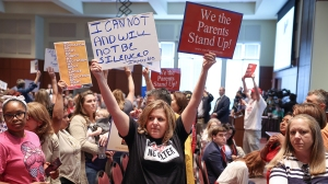 Shelley Slebrch and other angry parents and community members protest after a Loudoun County School Board meeting was halted by the school board because the crowd refused to quiet down, in Ashburn, Virginia, U.S.  June 22, 2021. REUTERS/Evelyn Hockstein