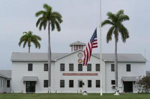 In this photo reviewed by U.S. military officials, a flag flies at half-staff in honor of the U.S. service members and other victims killed in the terrorist attack in Kabul, Afghanistan, at Marine Corps Security Force Company, Friday, Aug. 27, 2021, in Guantanamo Bay Naval Base, Cuba.