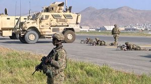 U.S soldiers stand guard along a perimeter at the international airport in Kabul, Afghanistan, Monday, Aug. 16, 2021. (AP Photo/Shekib Rahmani) (AP Photo/Shekib Rahmani)