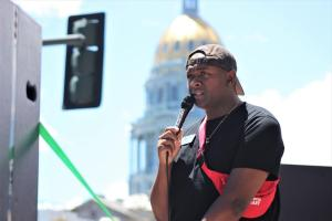 Denver Public Schools board member Tay Anderson addresses thousands of people participating in a June march for Black Lives Matter, organized by Denver Public Schools students, 2020.