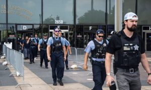 Dozens of Chicago police officers and personnel walk out of the Leighton Criminal Courthouse after attending the bond hearings for two brothers charged in connection with the fatal shooting of Officer Ella French, Tuesday, Aug. 10, 2021,