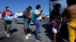 In this Sept. 20, 2021, file photo, migrants, many from Haiti, board a bus after they were processed and released after spending time at a makeshift camp near the International Bridge in Del Rio, Texas. (AP Photo/Eric Gay, File) (AP Photo/Eric Gay, File)
